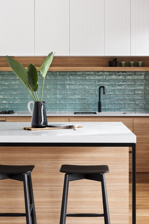 textured bohemian kitchen backsplash idea with wood cabinets and white countertop