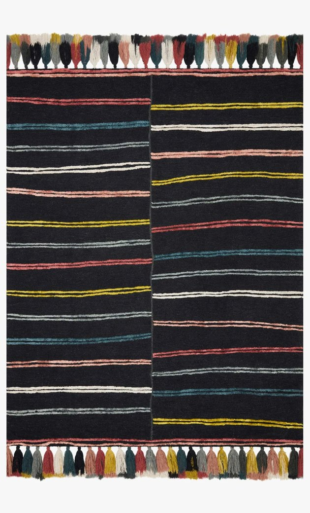 black rug with colorful stripes