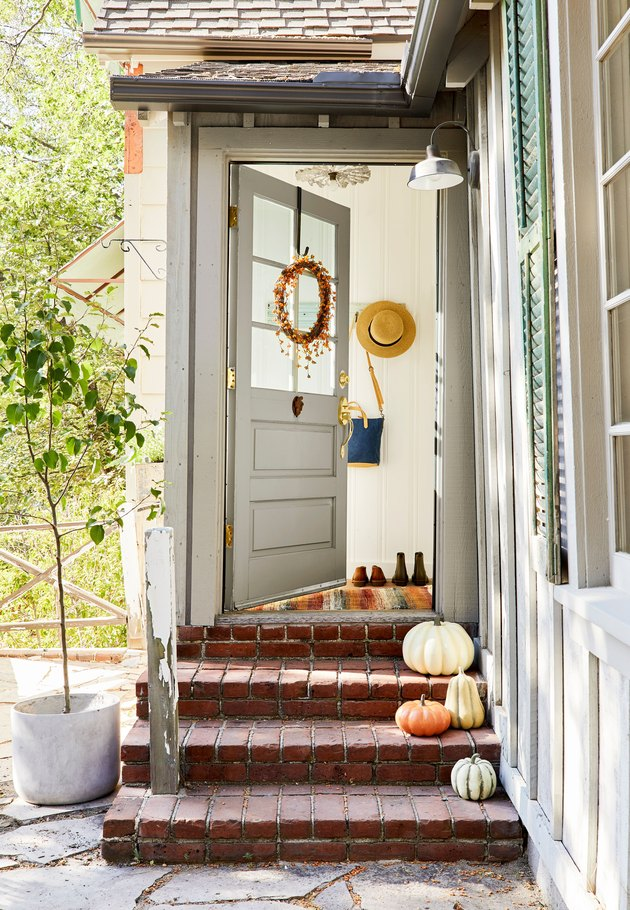 squash and fall pumpkins on brick steps