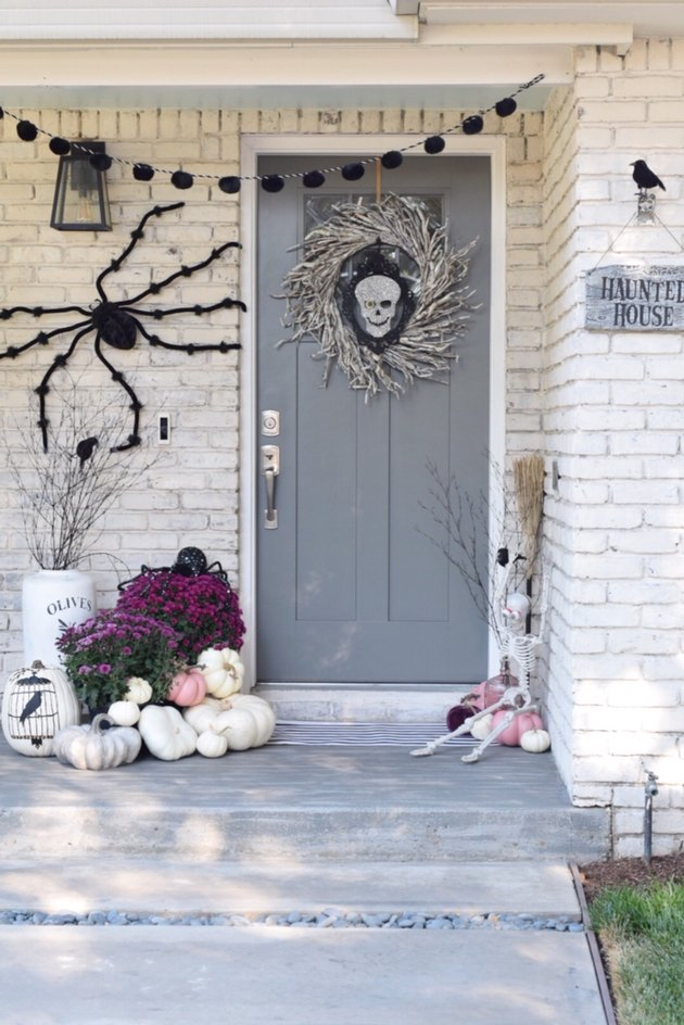 fall porch decor for Halloween with gray door