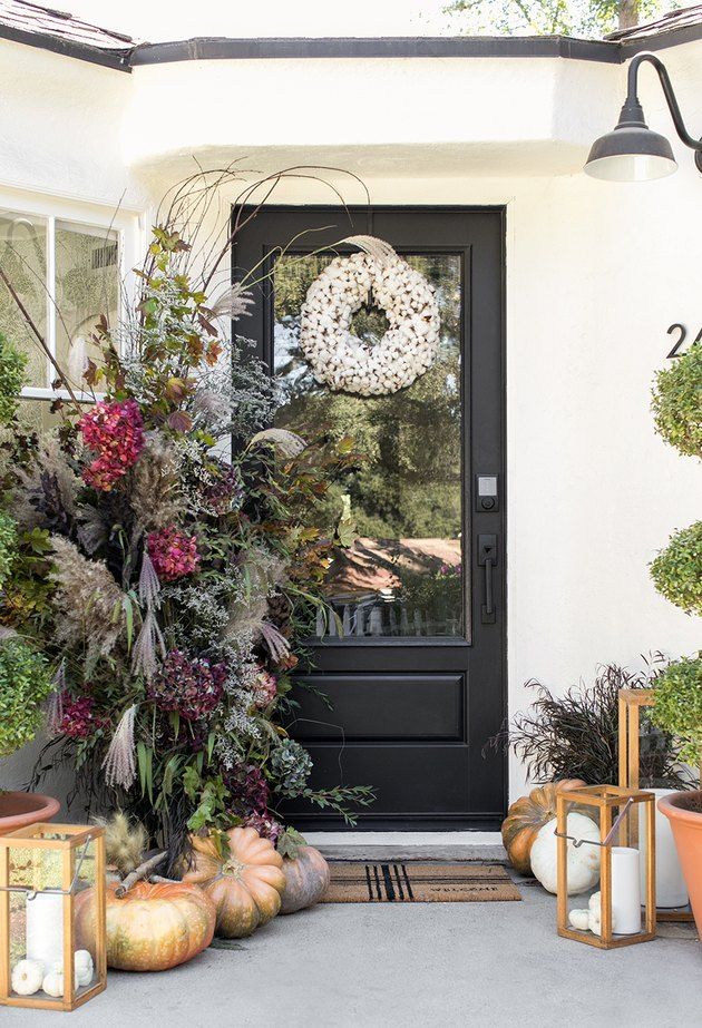 fall porch decor with flowers and cotton wreath