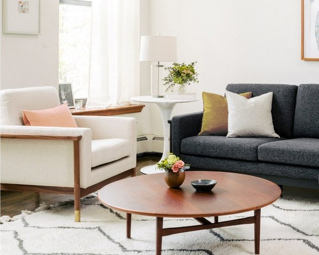 living room space with two tables and two couches