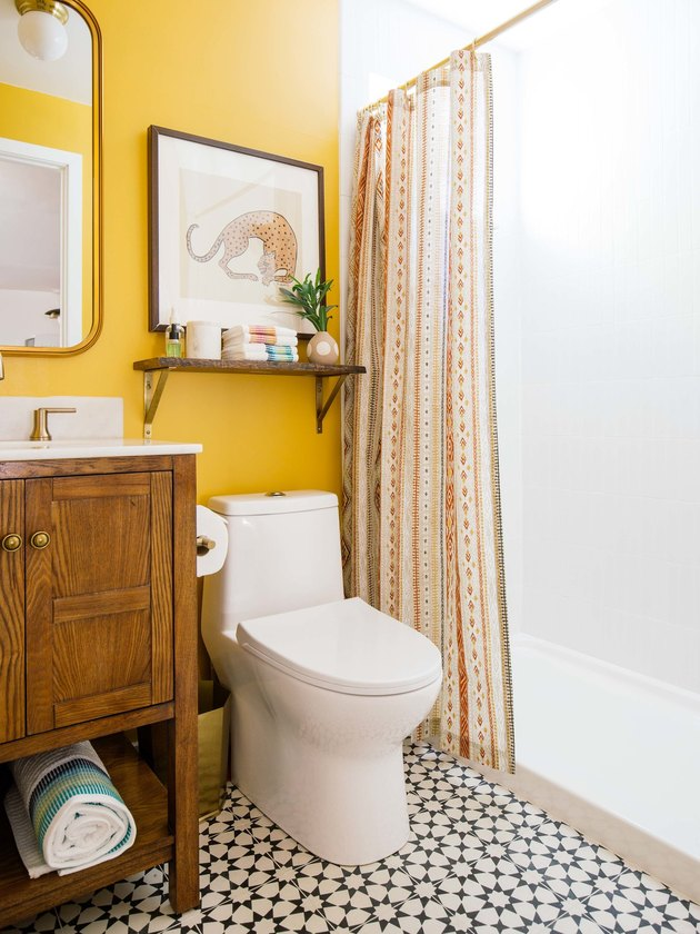 yellow bohemian bathroom ideas with wood vanity cabinet and patterned floor tile