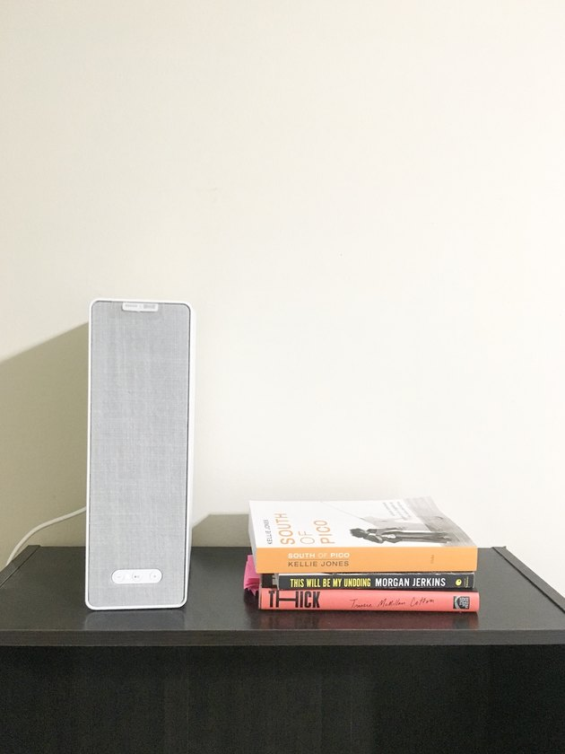 bookshelf with books and speaker
