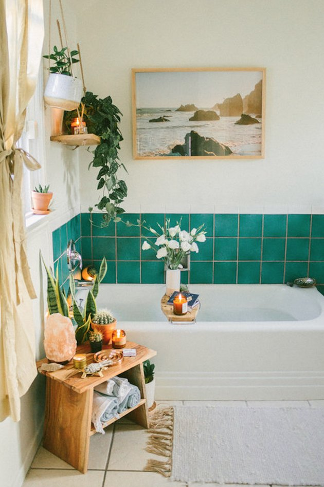 bohemian bathroom idea with green wall tile and potted plants