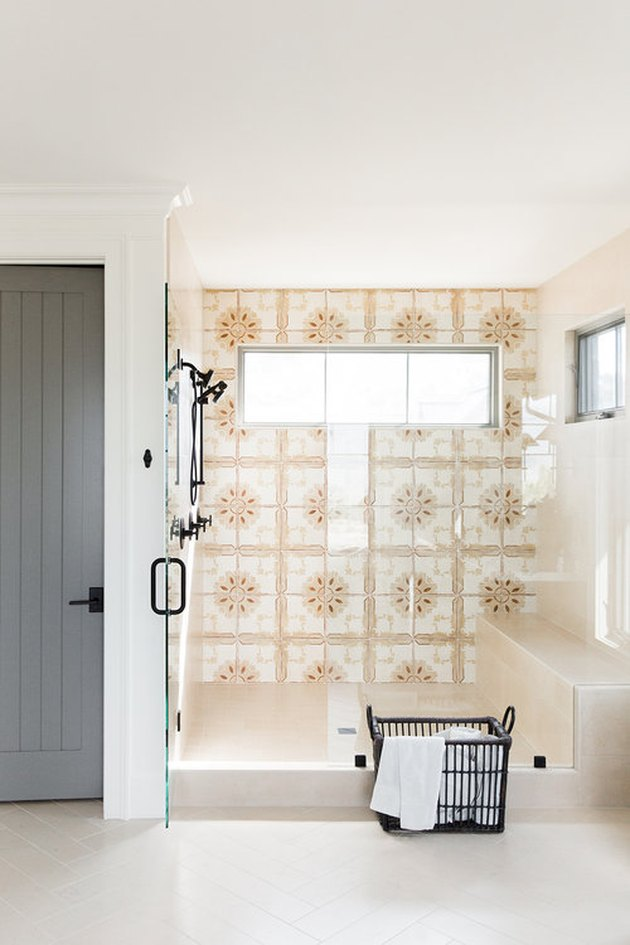 bohemian bathroom idea with patterned wall tile and walk-in shower