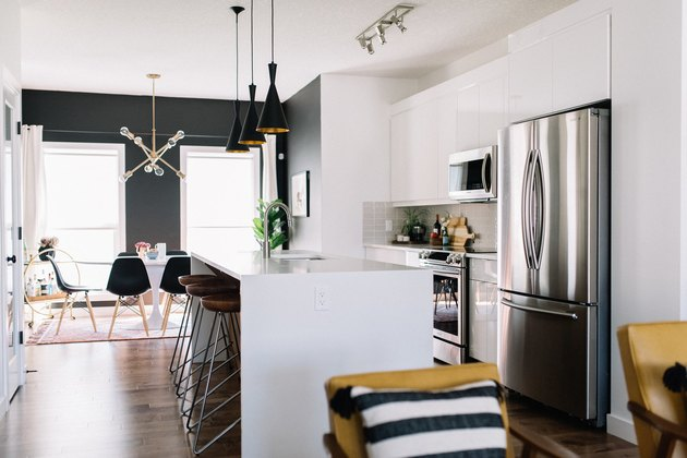 midcentury modern kitchen with pendant lighting above kitchen island