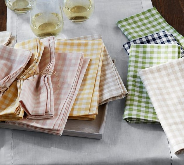 view of table with gingham napkins and wine glasses