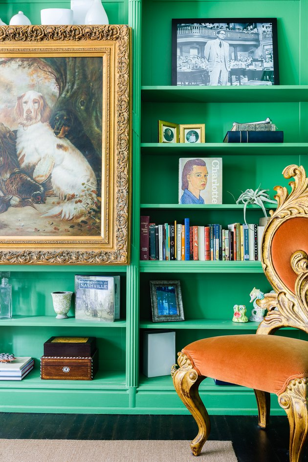 Green home office library with antiques, art and Victorian details by JL Design
