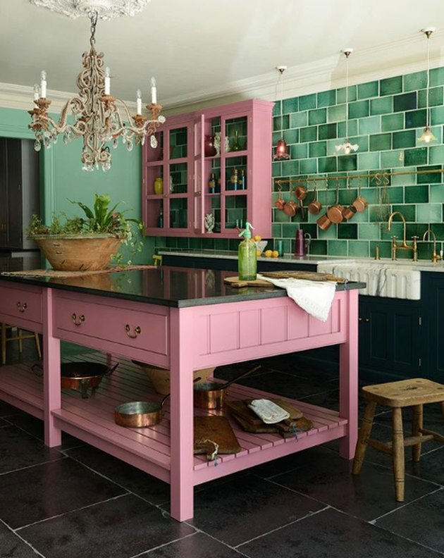 pink and green kitchen color idea with pink island and green backsplash