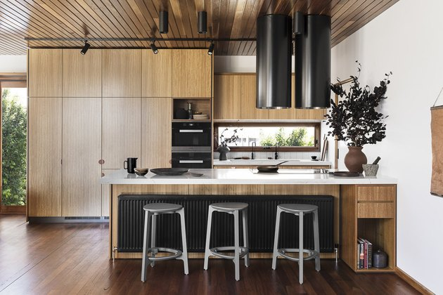 minimalist kitchen with track lighting and wood cabinets