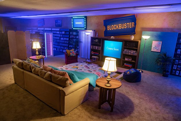 interior of blockbuster store with couch and TV