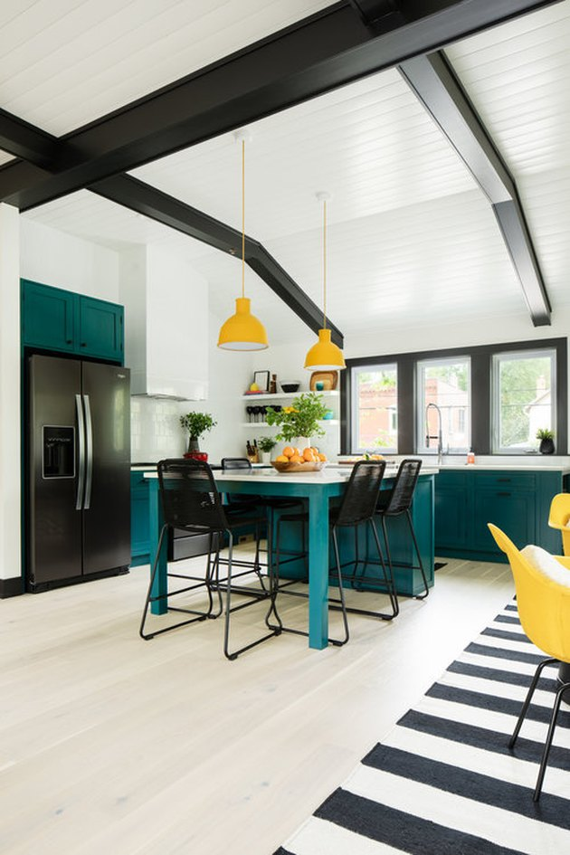 teal and yellow kitchen color idea with black ceiling beams