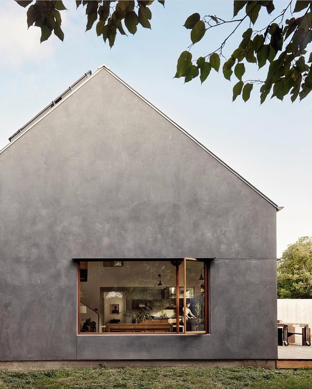 Bauhaus house with minimalist aesthetics in charcoal and an open window