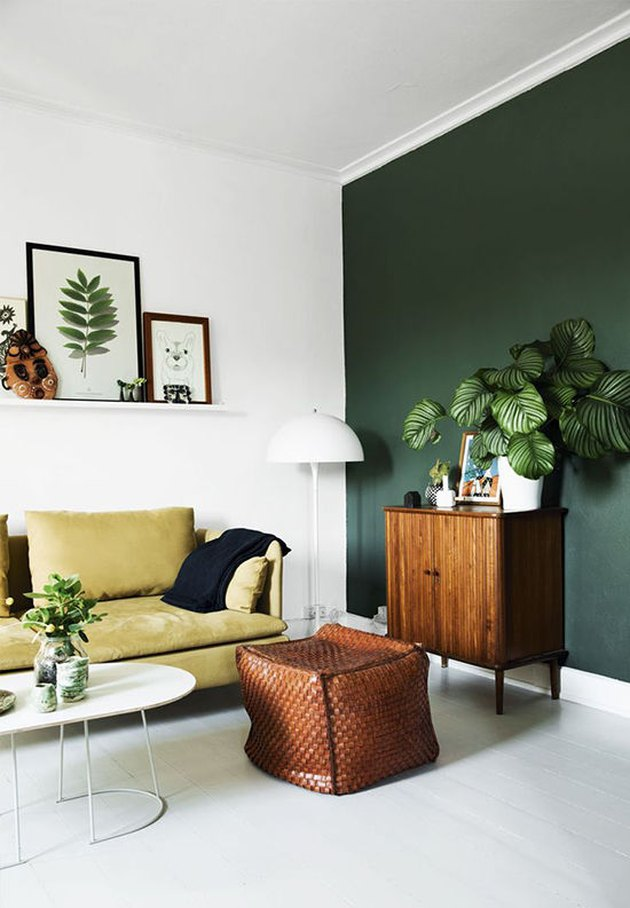 hunter green accent wall in living room