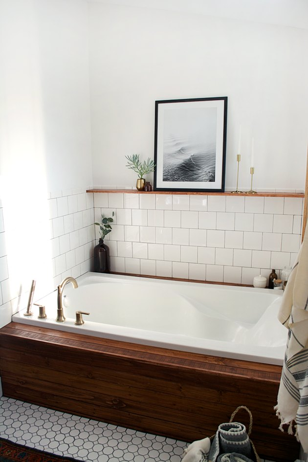 Drop-in bathtub with white wall tile