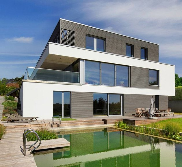 Bauhaus house with pool in backyard and outdoor furniture
