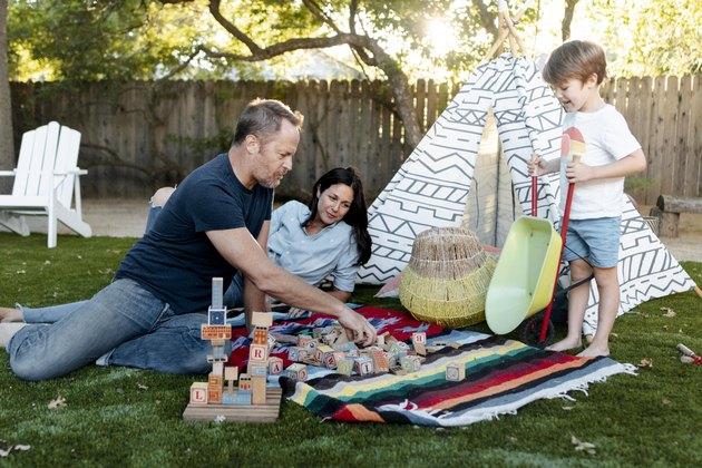 Gary, Lisa and Ronan in their backyard.