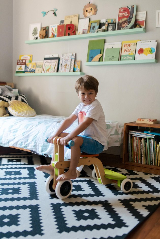 Ronan in his room with shelving made by Gary.