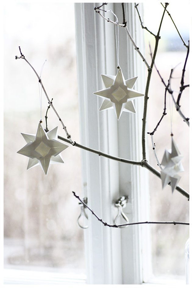 White star ornaments on bare limbs