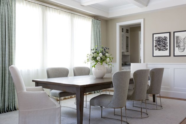 dining room decor idea with wainscoting and floor-to-ceiling drapery