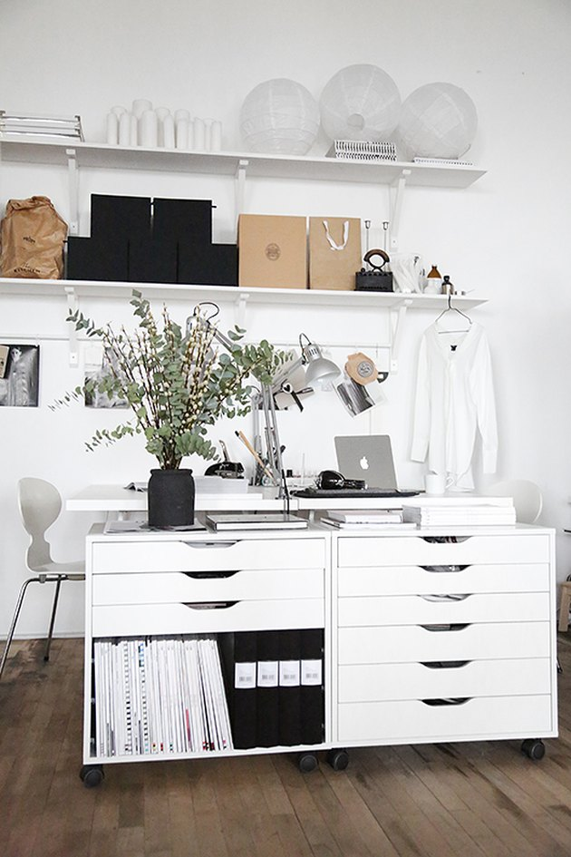 Home Office for Two White file drawers, face to face desks, shelves.