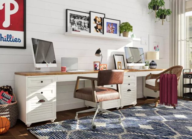 Home Office for Two Matching desks with computer screeens, leather desk chairs, area rug, shiplap wall.