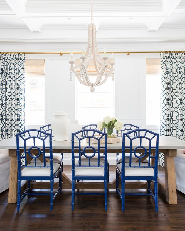 dining room curtain idea with chandelier and blue chairs