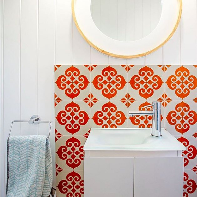 white bathroom with orange moroccan tiles