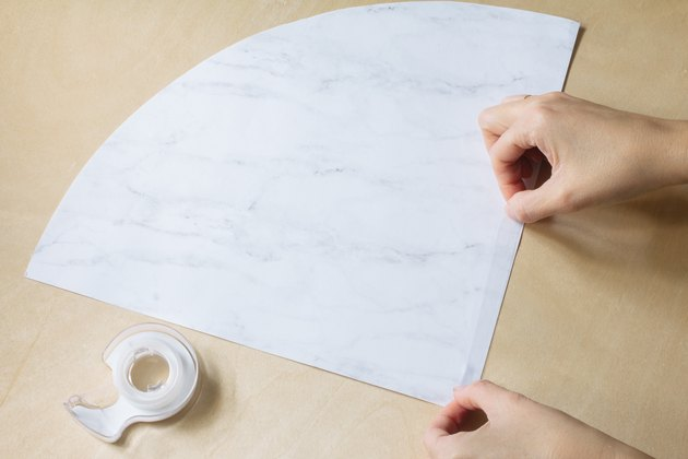 Sticking double-sided tape to paper