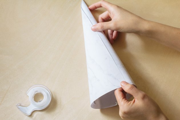 Rolling paper into a cone shape