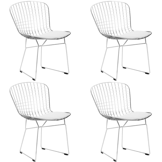 Four white metal armless grid dining chairs