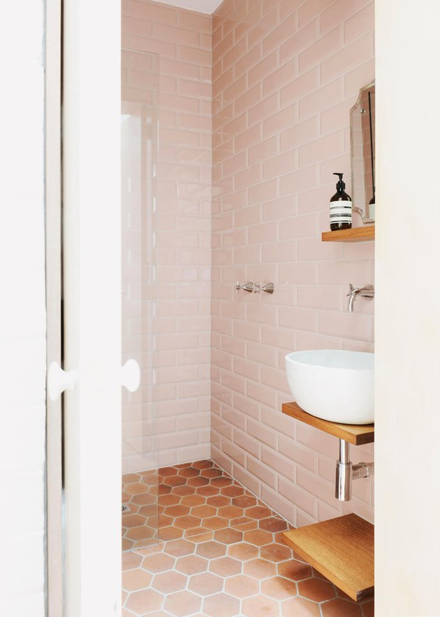 blush bathroom with terra cotta color floor tiles