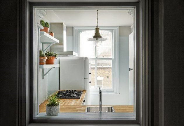 gray kitchen with eggshell blue paint destails and windows Tone On Tone Paint Ideas