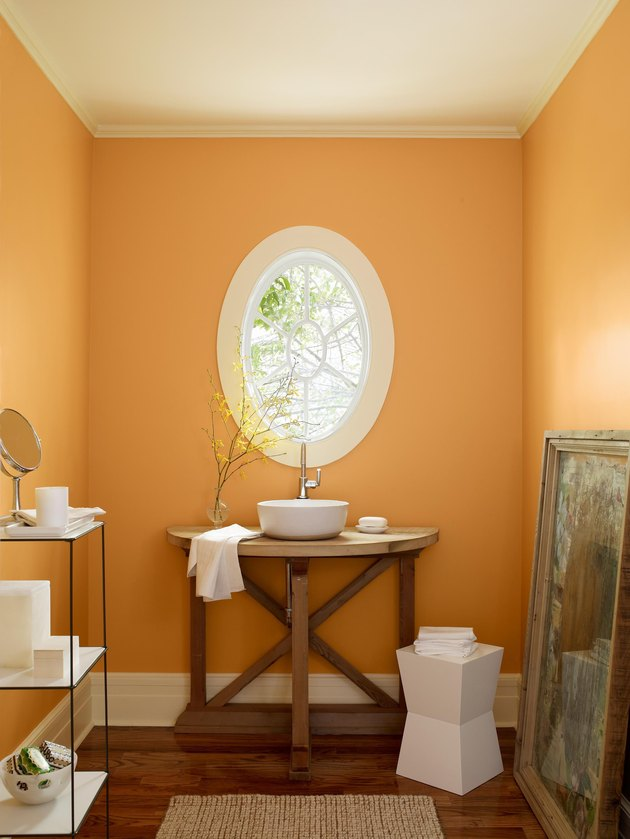 rustic bathroom with orange walls
