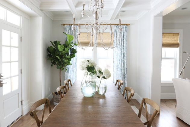 dining room decor idea with white walls and chandelier