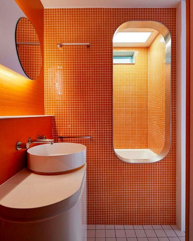 small orange tiles in bathroom