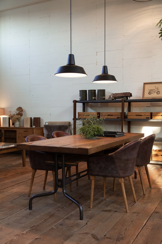 Industrial dining room lighting idea with metal factory pendants