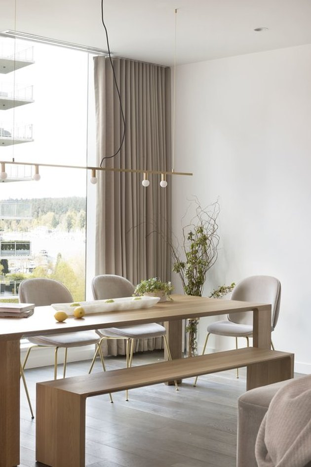 dining room curtain idea with wooden table and neutral curtains