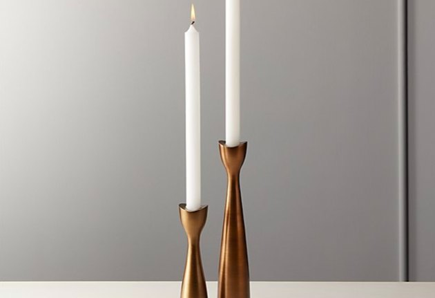 two candle on bronze candle holders