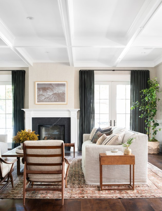 white living room with terra cotta color rug and white furniture
