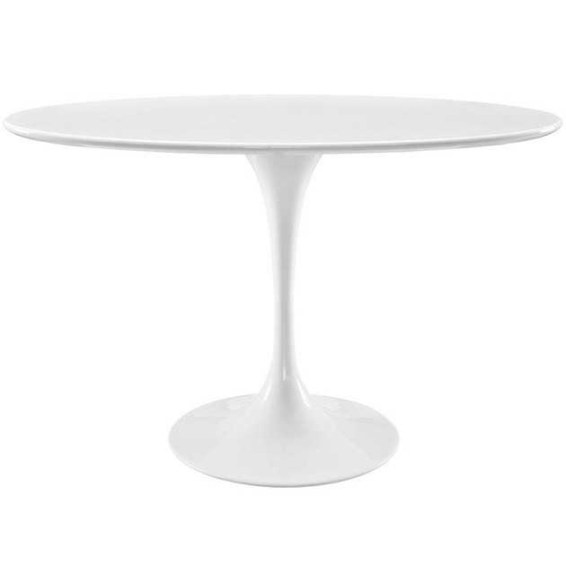White, round mid-century dining table