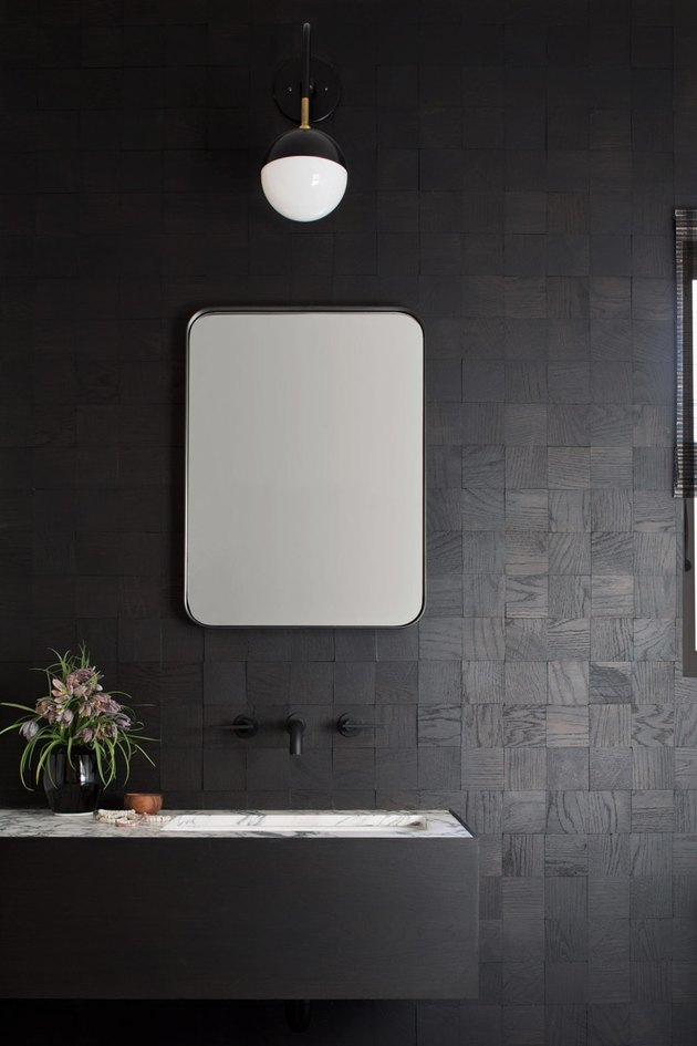 undermount bathroom sink with black vanity and walls