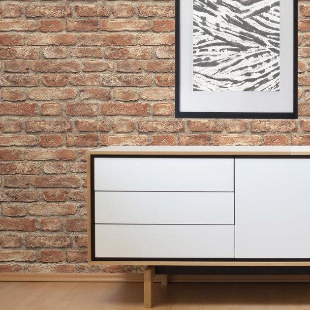 brick wallpaper wall with dresser
