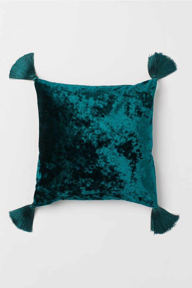 green velvet pillow with tassels