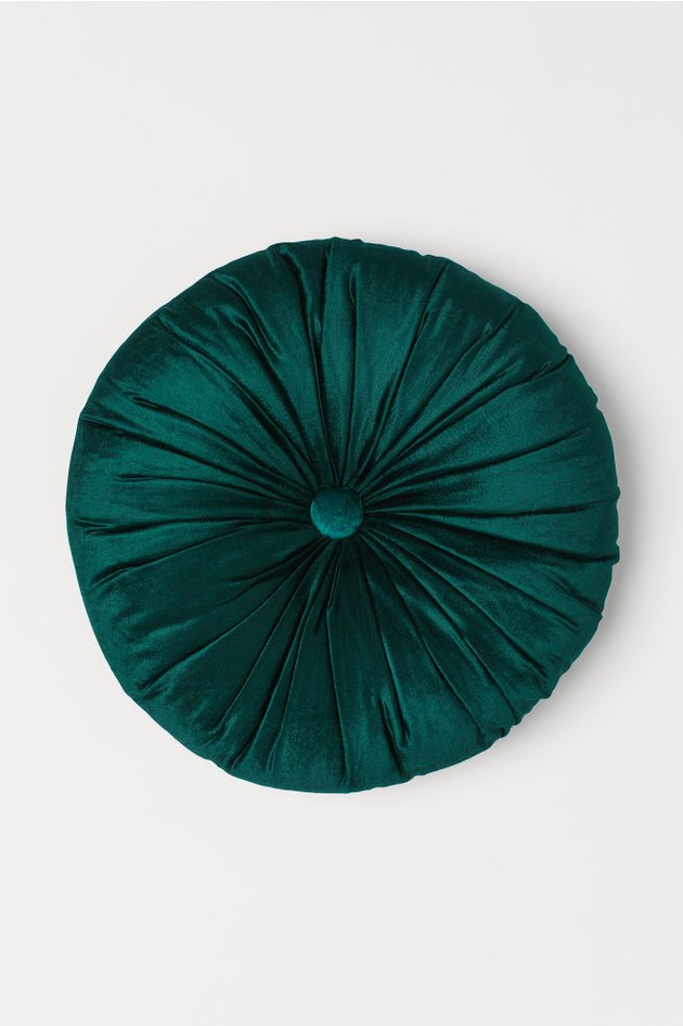 green velvet round cushion