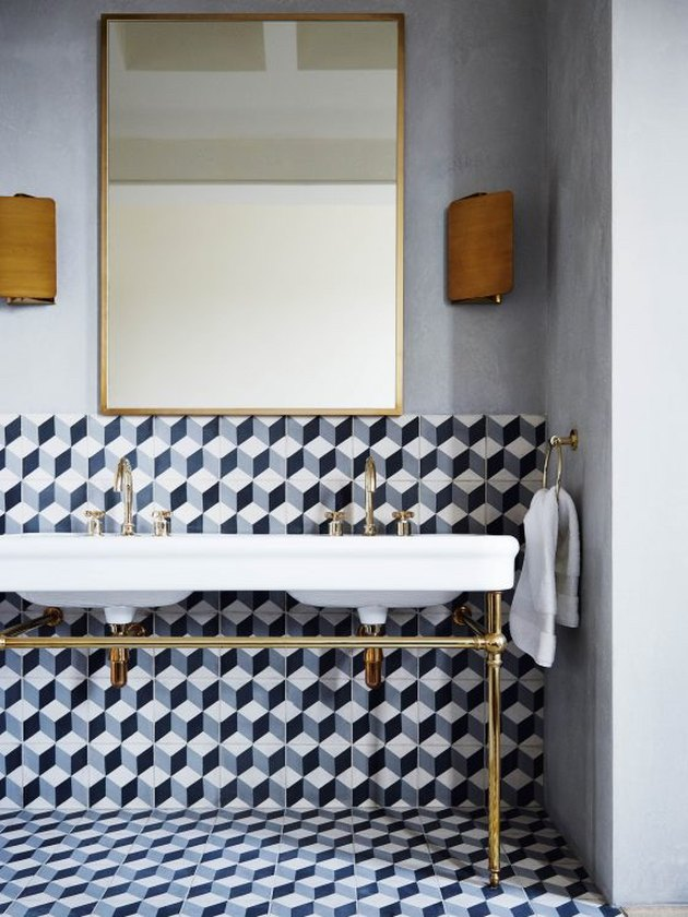 modern bathroom with patterned wall and floor tile