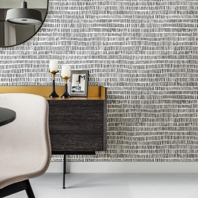 black and white wallpaper with chair and desk nearby