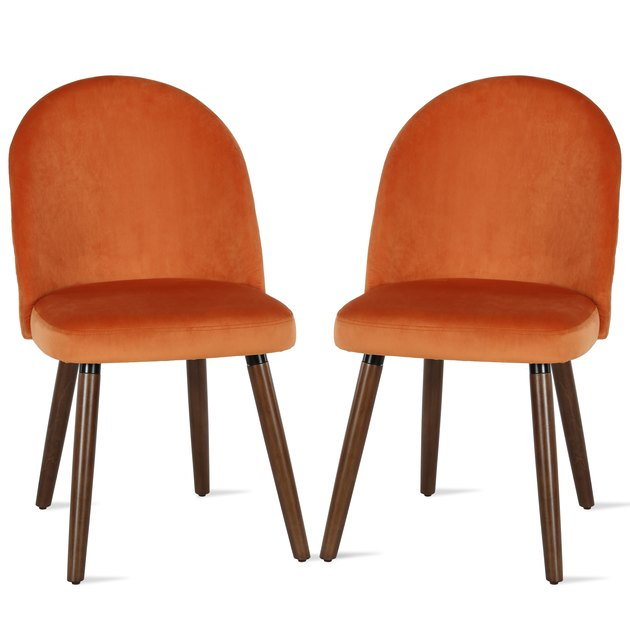 two orange dining chairs