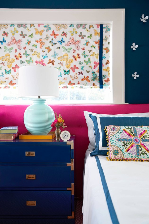 colorful bedroom with butterfly painting